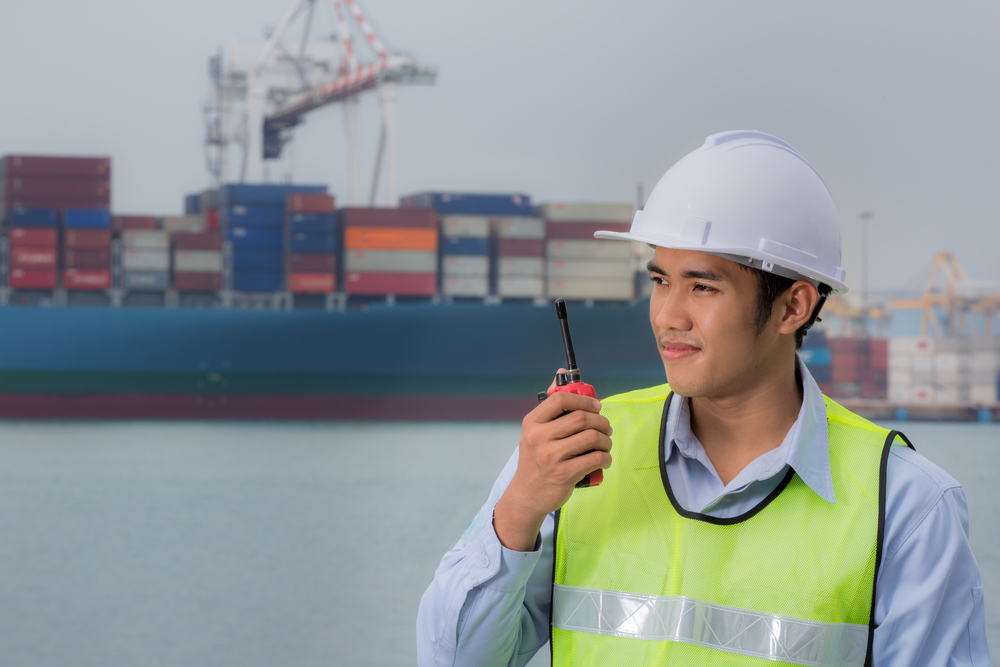 man with a radio in a port