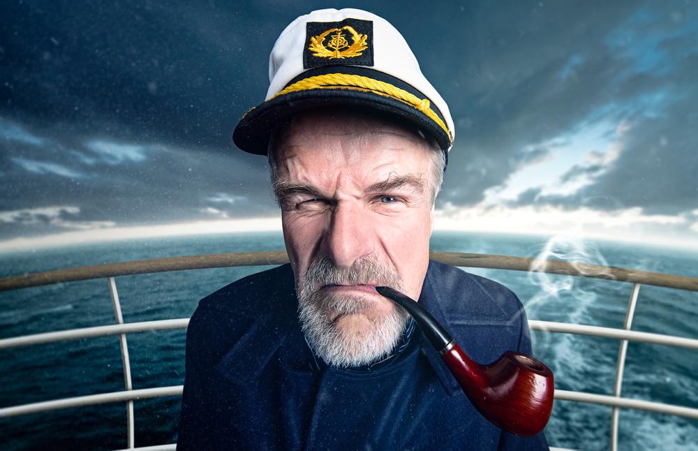 A ship captain smoking a pipe