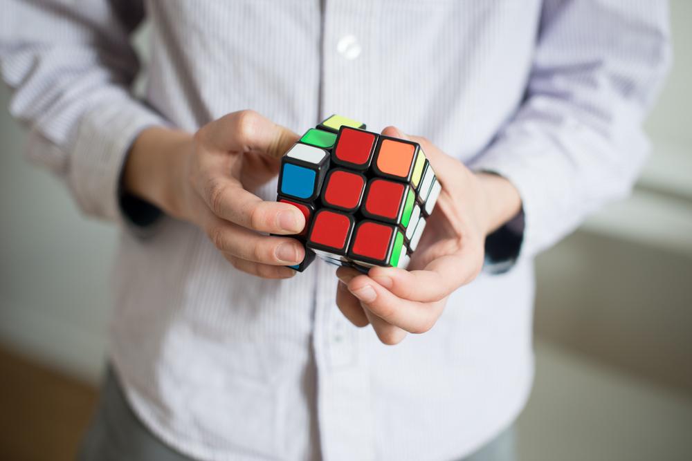 Man solves a Rubik's cube