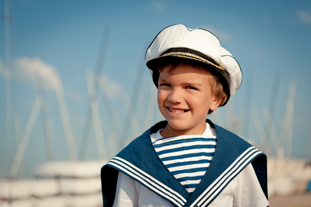 A boy dressed as a seafarer