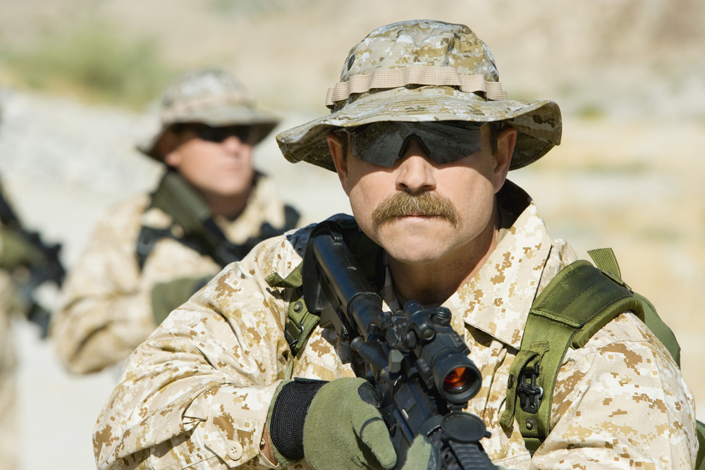 An armed soldier with a mustache