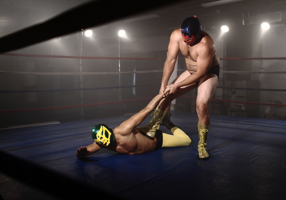 two men wrestle