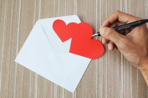 Two red hearts and a white envelope