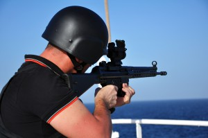 On board armed security aiming at sea