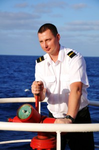 A seafarer aiming with a water spray