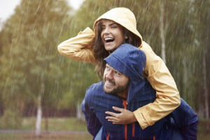 A couple is happy in the rain