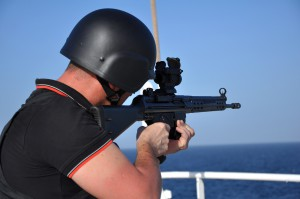 An armed guard aiming