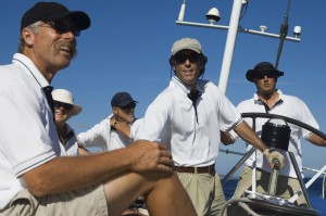A yacht crew of five men sailing