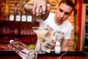 Barman pouring a Margarita cocktail