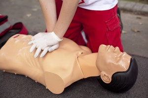 Rescuer trains first aid on a dummy