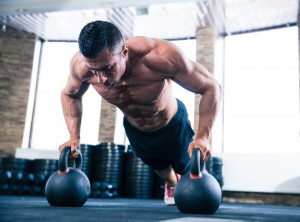 Man doing kettlebell push ups