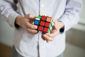 Man solving a Rubik's Cube to beat loneliness